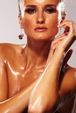 Wet Face. Wet Woman face -  fashion model on greay background Royalty Free Stock Images