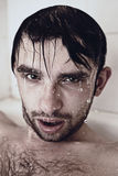 Wet face men in the shower Royalty Free Stock Photos