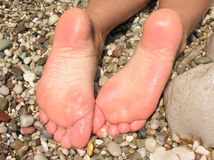 Wet feet. Close-up over rocks Stock Photos