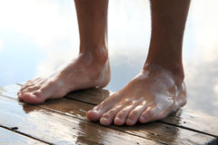 Wet feet. Boy who is about to jump into the water Royalty Free Stock Images
