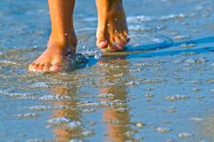 Wet feet on the clean sea in the morning. Wet feet on the clean sea stock photos