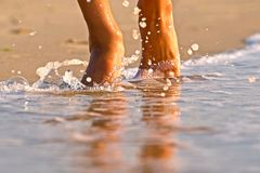 Wet feet on the clean sea in the morning. Wet feet on the clean sea royalty free stock photos