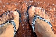 Wet feet! Cold feet! summer is here!. Wetting your feet at a water park is just a typical thing to do on a hot summer day while visiting a water park resort or Stock Image