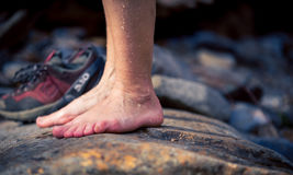 Wet feet on a stone Stock Photography