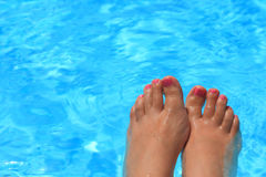 Wet female feet Stock Photography
