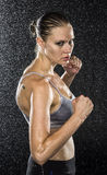 Wet Female Fighter in Combat Pose Looking Fierce Royalty Free Stock Image