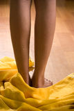 Wet female legs with towel on wooden floor Royalty Free Stock Photos