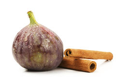 Wet fig and cinnamon sticks Stock Photo