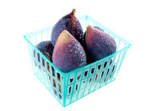 Wet figs in a basket. Figs in a basket on white background Stock Photography