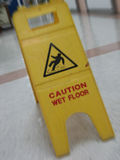 Wet floor caution Royalty Free Stock Photo