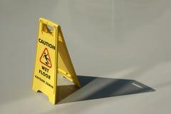 Wet floor caution Stock Photo