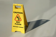 Wet floor caution Stock Images
