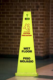 Wet Floor. Caution Wet floor sign agaist a bathroom Stock Images