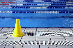 Wet floor cone signal in the big pool Royalty Free Stock Photography
