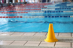 Wet floor cone signal in the indoor pool Stock Photo