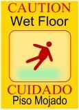 Wet Floor Cuidado Piso Mojado. Wet floor sign, safty comes first, cuidado piso mojado Stock Photos