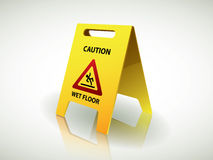 Wet floor sign. Caution - wet floor sign on shiny surface Stock Photo