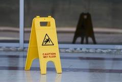 Wet floor sign stock photos