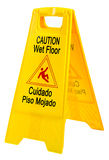 Wet floor sign. Yellow wet floor sign with english and spanish messages Stock Images