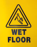 Wet Floor Sign. Yellow Wet Floor Sign Close-up Royalty Free Stock Image