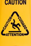 Wet floor sign. In a pool Royalty Free Stock Photography