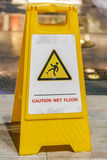 Wet floor sign. Caution wet floor sign at a sidewalk Royalty Free Stock Photos