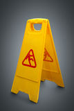 Wet floor sign on grey Stock Photos