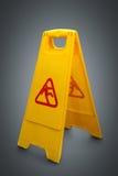 Wet floor sign on grey Stock Photos
