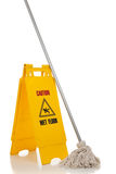 Wet floor sign and mop on white background Stock Images