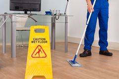 Wet floor sign in office Royalty Free Stock Image