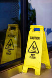 Wet floor sign. In office room Royalty Free Stock Photos