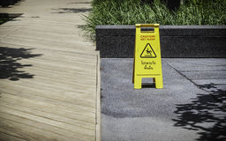 Wet floor sign. In the park Royalty Free Stock Image