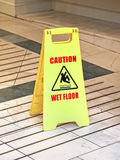 Wet floor sign. Plastic wet floor sign on marble surface Royalty Free Stock Image