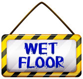 Wet floor signboard. On a white background Royalty Free Stock Image