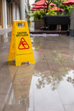 Wet floor warning sign on the floor in hotel corridor Stock Photography