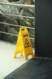 Caution Wet Floor. Yellow sign that alerts for wet floor Royalty Free Stock Photography