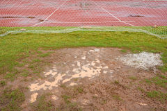 Wet football field Royalty Free Stock Images