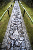 Wet footpath in Koto-in. Wet paved footpath between bamboo railings in the formal garden at Koto-in, a sub temple of Daitoku-ji in Nara , Japan Royalty Free Stock Photos
