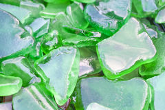 Wet Fragments of Green Beach Glass Royalty Free Stock Photos