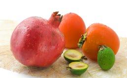 Wet fruits on white Royalty Free Stock Photos