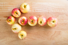 Wet fuji apple on wood chop block and on wood table Royalty Free Stock Photo