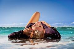 Wet girl. Enjoying sun and water in tropical sea Stock Photos