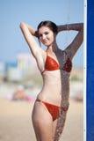 Wet girl in bikini on open air Stock Photo