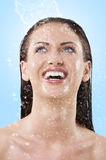 Wet girl laughing to the sky Stock Photos