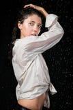 Wet girl in rain Stock Images