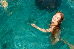 Wet girl in the swimming-pool. In the evening Stock Photos