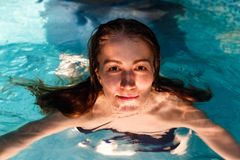 Wet girl in the swimming-pool Royalty Free Stock Image
