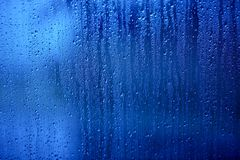Wet Glass. Water Drops on the Blue Glass - Background, Texture Royalty Free Stock Images