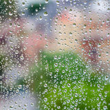 Wet glass with droplets, colorful square photo Stock Images