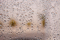 Wet glass with drops of rain Royalty Free Stock Photography
